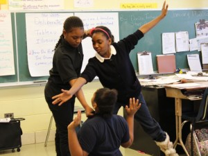 Students at Medgar Evers School participate in an anti-bullying workshop.