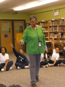 A teacher at Medgar Evans school in Chicago, IL mentors another teacher using the Creative Directions' drama techniques.